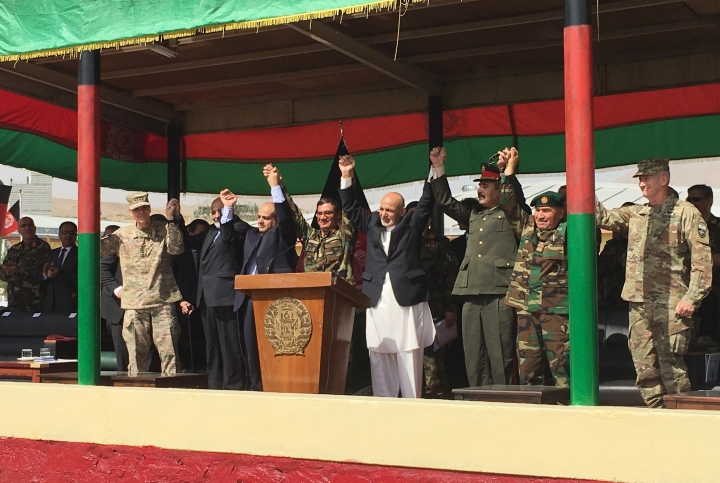 Afghan President Ashraf Ghani, to the right of the podium, is joined by top U.S. and Afghan military leaders for the launch of the Afghan Army's new special operations corp on Sunday, Aug. 20, 2017, at Camp Morehead, a training base southeast of Kabul. (AP Photo/Lolita Baldor)