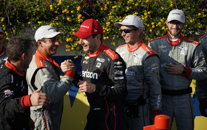 Will Power, center, celebrates with his crew after winning the IndyCar auto race at Pocono Raceway, Sunday, Aug. 20, 2017, in Long Pond, Pa. (AP Photo/Matt Slocum)