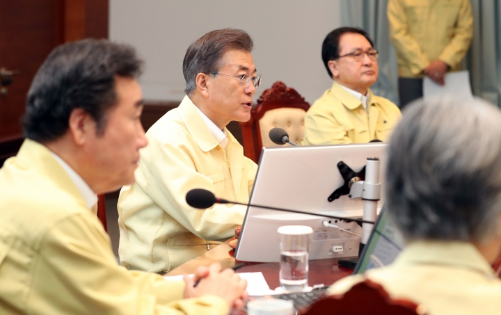 South Korean President Moon Jae-in, center, presides over a cabinet meeting at the presidential Blue House in Seoul, South Korea, Monday, Aug. 21, 2017. U.S. and South Korean troops have begun annual drills that come after tensions rose over North Korea's two intercontinental ballistic missile tests last month. Moon said Monday the drills are defensive in nature. He says the drills are held regularly because of repeated provocations by North Korea. (Kim Ju-hyung/Yonhap via AP)