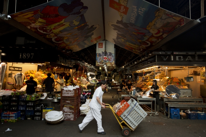 Vendors prepare their stalls at the Boqueria market in Raval, the neighbourhood in central Barcelona where the vehicle attack took place, in Barcelona, Spain, Spain, Monday, Aug. 21, 2017. (AP Photo/Emilio Morenatti)