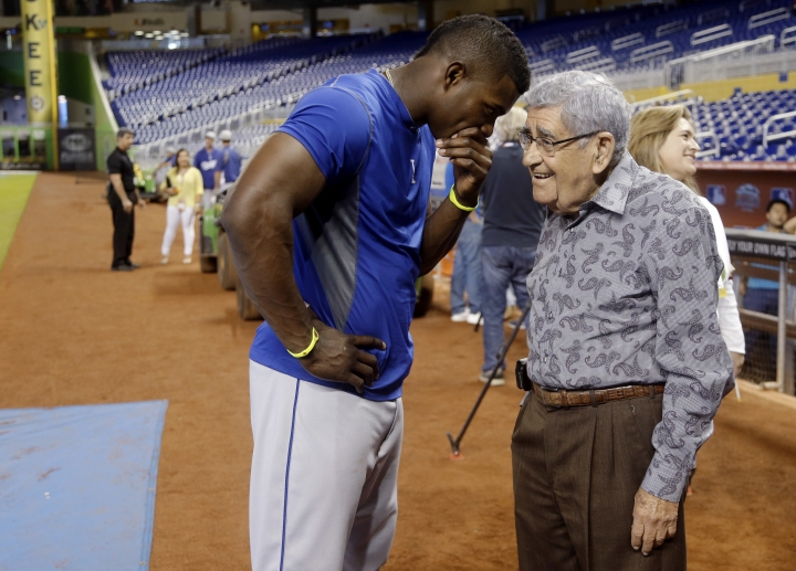 "FILE - In this Wednesday, Aug. 21, 2013, file photo, Los Angeles Dodgers right fielder Yasiel Puig, left, talks with Spanish language broadcaster Rafael ""Felo"" Ramirez during batting practice before the Dodgers' baseball game against the Miami Marlins, in Miami. Ramirez, a Hall of Fame baseball radio broadcaster who was the signature voice for millions of Spanish-speaking sports fans over three decades, died Monday, Aug. 21, 2017. He was 94. (AP Photo/Lynne Sladky, File)"