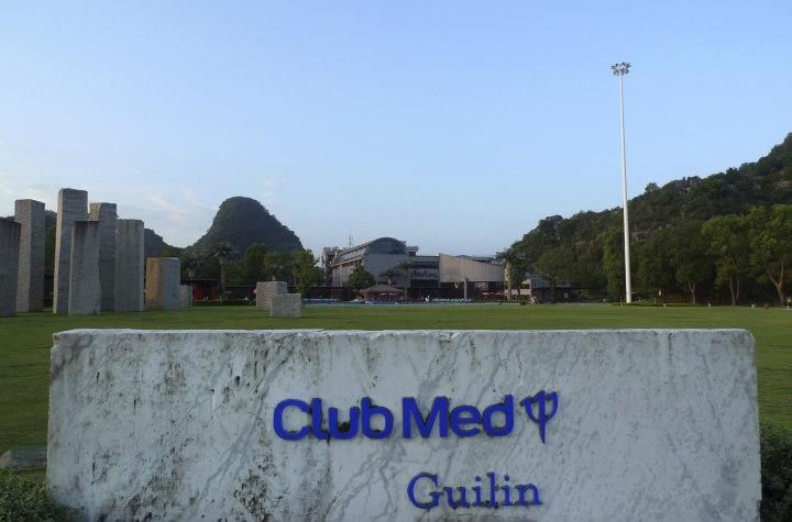 In this Aug. 12, 2016 photo, a sign welcomes visitors to Club Med's resort in Guilin, southwestern China. China is a relatively new and expanding market for the Western holiday company, which has opened four resorts in the country since 2010 and was taken over in 2015 by Chinese conglomerate Fosun. (AP Photo/Kelvin Chan)