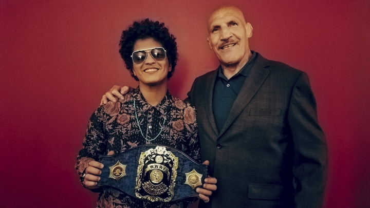 "This Tuesday, Aug. 22, 2017, photo provided by Shaun Hoffman, shows Bruno Mars, left, meeting retired professional wrestler Bruno Sammartino, right, as Mars holds Sammartino's world champion belt, coinciding with a concert as part of Mars' 24K Magic World Tour in Pittsburgh. The pop singing sensation and the retired professional wrestler met Tuesday after Sammartino heard through friends that Mars, born Peter Gene Hernandez, was nicknamed ""Bruno"" by his father because he was a ""chunky"" baby. (Shaun Hoffman via AP)"