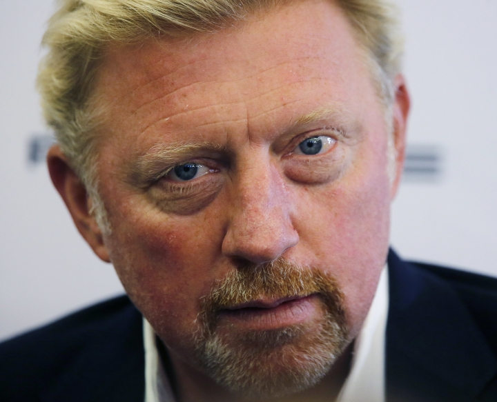 German tennis legend Boris Becker waits for the beginning of a news conference speaking about his new role in the German Tennis Federation in the town hall in Frankfurt, Germany, Wednesday, Aug. 23, 2017.As 'Head of Tennis' Becker now is responsible for the men's tennis of the German Tennis Federation. (AP Photo/Michael Probst)