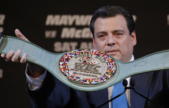 Mauricio Sulaiman, president of the World Boxing Council, holds up a specially made belt for a fight between Conor McGregor and Floyd Mayweather Jr., during a news conference Wednesday, Aug. 23, 2017, in Las Vegas. (AP Photo/John Locher)