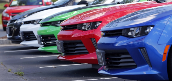 In this Wednesday, April 26, 2017, photo, cars are lined up in the lot of a Chevrolet dealership in Richmond, Va. The buyout option at the end of a car lease can be an attractive opportunity or a tool for damage control. (AP Photo/Steve Helber)