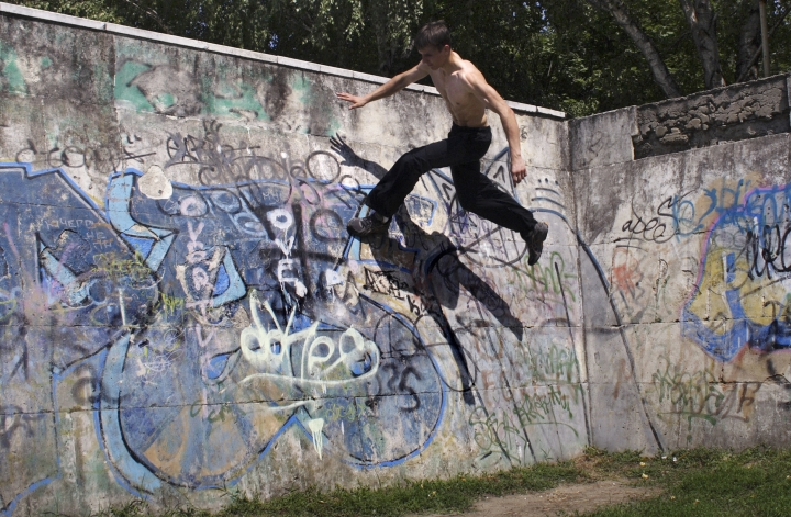 "FILE - A Thursday, Aug. 6, 2009 file photo of a Parkour practitioner jumping in the southern Russian city of Krasnodar, about 1,200 km (750 miles) south of Moscow. Global organizers of street-running known as parkour have set the International Gymnastics Federation (FIG) a deadline to end attempts to control their sport. Parkour Earth asks FIG President Morinari Watanabe in an open letter for an ""urgent meeting"" by Sept. 15 to formalize its right to govern. It's the latest dispute involving Olympic sports bodies for control of popular youth-oriented events. (AP Photo/Yuri Ivashchenko, File)"