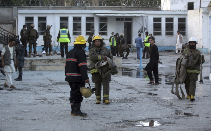 Fire department personnel leave a Shiite mosque after an attack in Kabul, Afghanistan, Friday, Aug. 25, 2017. A senior hospital official says at least 20 people were killed in the hours-long siege of a Shiite Muslim mosque in the Afghan capital of Kabul. (AP Photo/Massoud Hossaini)
