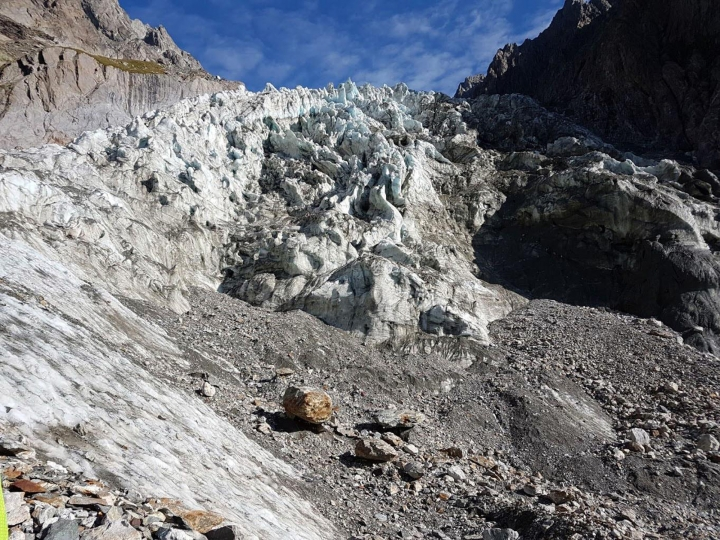 In this photo taken on Thursday, Aug. 24, 2017 the area where corpses were spotted on Mont Blanc's Southern face. The corpses were spotted on Wednesday on the Mirage glacier by an alpinist. Italian mountain rescue crews say they have recovered the remains of two, or possibly three, hikers on a glacier on Mont Blanc's southern face likely dating from the 1980s or 1990s. Alpine rescue commander Delfino Viglione said Friday the bodies were discovered this week by a hiker who was searching the area for artifacts from decades-old plane crashes, including one in the 1960s that killed more than 100 people. (Italian Firefighters via AP)
