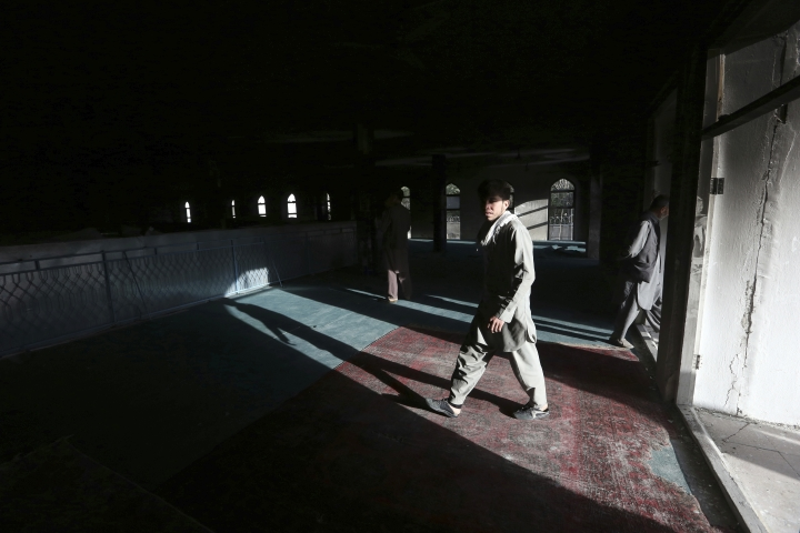 Afghan men are seen inside a Shiite mosque where gunmen attacked during Friday prayers, in Kabul, Afghanistan, Saturday, Aug. 26, 2017. Militants stormed the packed Shiite mosque during Friday prayers in an attack killing worshippers, an official said. (AP Photo/Rahmat Gul)