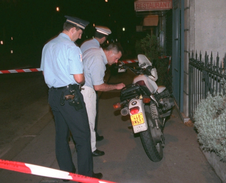 FILE - In this Sunday Aug.31, 1997 file photo police prepare to take away for investigation the motorbike of a photographer that was chasing the car of Diana, Princess of Wales, when a crash took place in a tunnel along the Seine river in Paris. Diana was killed in the crash.The way Princess Diana died 20 years ago this month _ in a high-speed Paris car crash while she and her boyfriend were being chauffeured by an intoxicated driver and pursued by photographers _ shocked and angered the public. It also preserved her in memory as a glamorous, beloved and vulnerable victim. (AP Photo/Jacques Brinon)