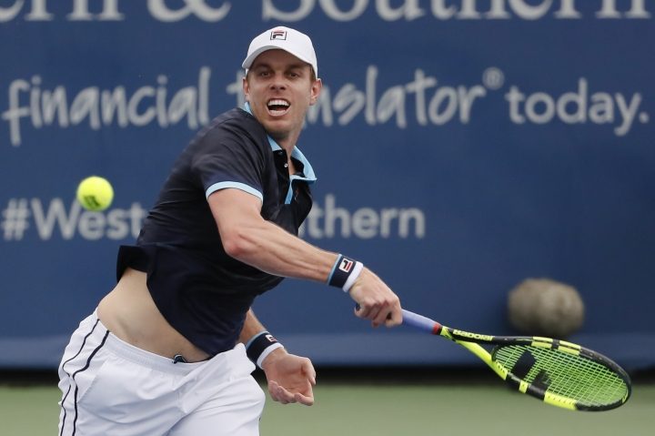 FILE - In this Aug. 14, 2017, file photo, Sam Querrey returns to Stefan Kozlov during the first round at the Western & Southern Open tennis tournament in Mason, Ohio. Querrey is coming off his first Grand Slam semifinal at Wimbledon in July and is seeded No. 17 at Flushing Meadows. (AP Photo/John Minchillo, File)