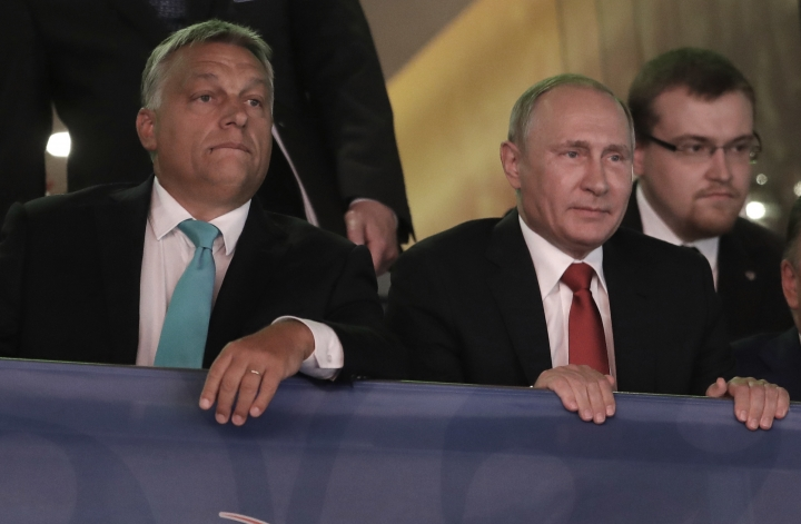 Russian President Vladimir Putin, right, and Hungarian Prime Minister Viktor Orban, left, arrive at the World Judo Championships as they meet in Budapest, Hungary, Monday, Aug. 28, 2017. (AP Photo/Petr David Josek)