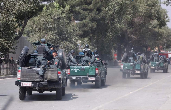 Afghan security personnel arrive at the site of an explosion near a bank in Kabul, Afghanistan, Tuesday, Aug. 29, 2017. The area where the explosion took place, in the center of the Afghan capital, is home to many businesses. The U.S. Embassy and the NATO headquarters are about 500 meters (yards) away. (AP Photo/Rahmat Gul)