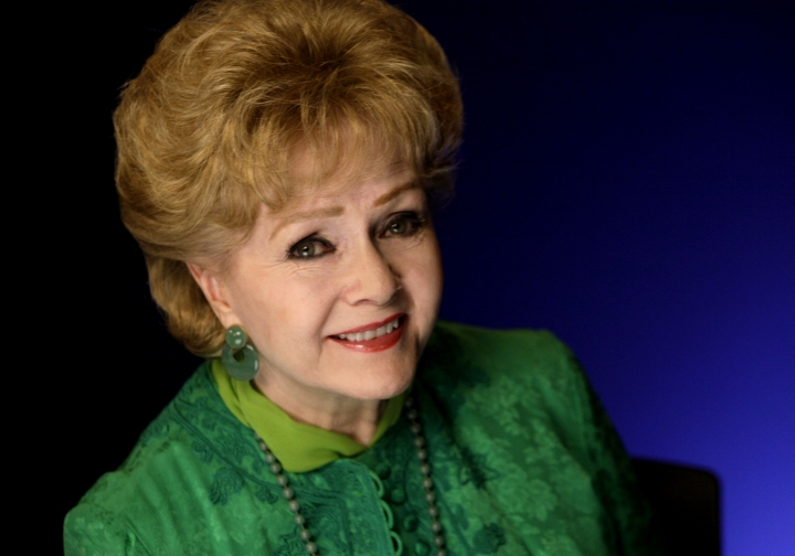 FILE - In this Oct. 14, 2011, file photo, actress Debbie Reynolds poses for a portrait in New York. The auction house Profiles in History said it will sell a 1926 Norman Rockwell painting of Benjamin Franklin signing the Declaration of Independence that belonged to Reynolds at an auction of the actress' possessions scheduled for Oct. 7 and 8, 2017. (AP Photo/Richard Drew, File)