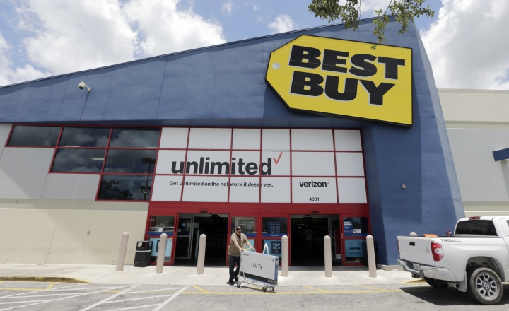 In this Monday, May 22, 2017, photo, Edward Calixto walks out of a Best Buy store with his purchased LED TV, in Hialeah, Fla. Best Buy Co., Inc. reports earnings, Tuesday, Aug. 29, 2017. (AP Photo/Alan Diaz)