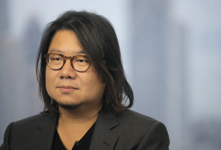 """In this Friday, Aug. 25, 2017, photo, Singaporean novelist Kevin Kwan listens to a reporter's questions during an interview in Hong Kong. Kwan was in Hong Kong promoting the third and last book in his 'Crazy Rich' trilogy – 'Rich People Problems.' His first book """"Crazy Rich Asians"""" released in 2013, rose quickly in the charts and became a best seller. (AP Photo/Vincent Yu)"""