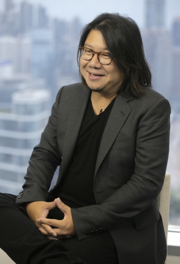 """In this Friday, Aug. 25, 2017, photo, Singaporean novelist Kevin Kwan talks during an interview in Hong Kong. Kwan was in Hong Kong promoting the third and last book in his 'Crazy Rich' trilogy – 'Rich People Problems.' His first book """"Crazy Rich Asians"""" released in 2013, rose quickly in the charts and became a best seller. (AP Photo/Vincent Yu)"""