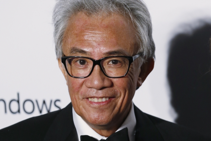 In this Saturday, March 14, 2015, photo, Hong Kong businessman and socialite David Tang, poses on the red carpet for the fundraising gala organized by amfAR (The Foundation for AIDS Research) in Hong Kong. Tang, a flamboyant and outspoken socialite and entrepreneur who founded the Shanghai Tang fashion brand, has died. He was 63. (AP Photo/Kin Cheung)