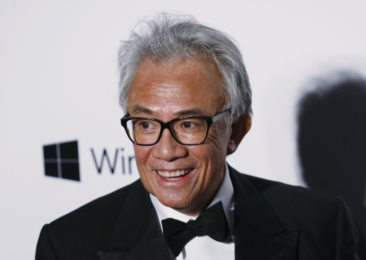 In this Saturday, March 14, 2015, photo, Hong Kong businessman and socialite David Tang poses on the red carpet for the fundraising gala organized by amfAR (The Foundation for AIDS Research) in Hong Kong. Tang, a flamboyant and outspoken socialite and entrepreneur who founded the Shanghai Tang fashion brand, has died. He was 63. (AP Photo/Kin Cheung)