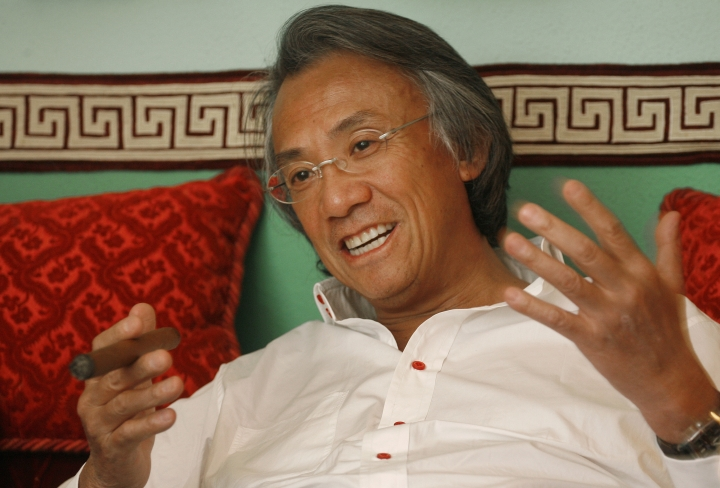 In this March 20, 2007 file photo, Hong Kong businessman David Tang gestures during an interview at his home in Hong Kong. Tang, a flamboyant and outspoken socialite and entrepreneur who founded the Shanghai Tang fashion brand, has died. He was 63. (AP Photo/Vincent Yu)