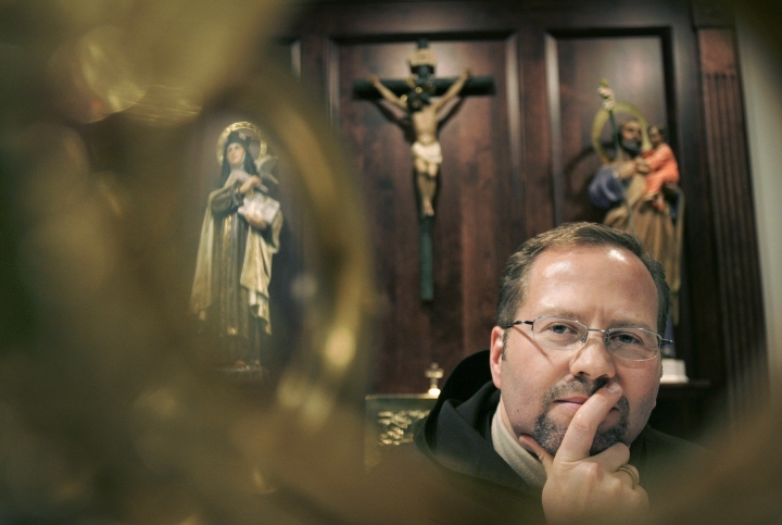 FILE - In this Feb. 4, 2009 file photo, Dennis-Anthony Wyrzykowski of Carmel Laboratories LLC, poses in front of an alter in a chapel at a Carmelite monastery, in Millbury, Mass. Wyrzykowski has filed a federal lawsuit against cosmetics giant L'Oreal, accusing the company of stealing patented technology in an anti-aging wrinkle cream that his charity was selling to raise money for the poor. Dennis Wyrzykowski and his company, Carmel Laboratories LLC, have been joined in the lawsuit by the University of Massachusetts Medical School, which developed the technology and licensed it to Carmel in 2009. (AP Photo/Steven Senne, File)