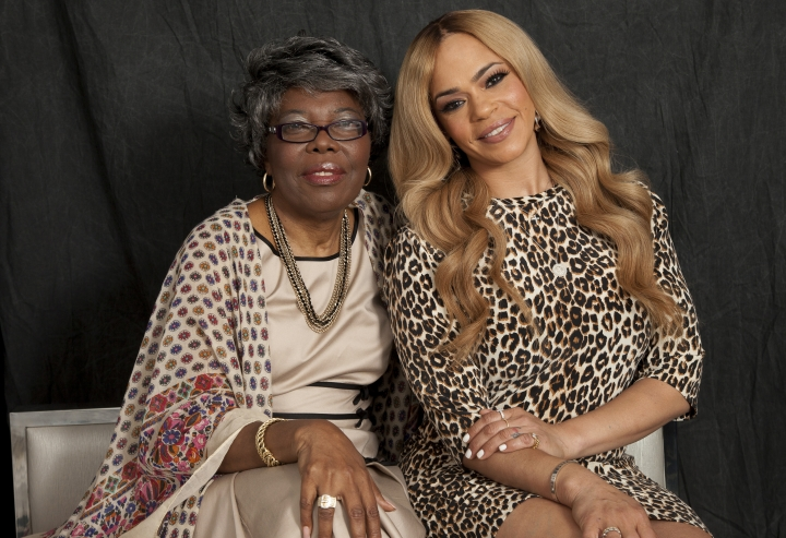 """In this Thursday, Aug. 17, 2017, photo, Voletta Wallace, left, and Faith Evans, right, pose for a portrait in New York. Wallace details the love for the Notorious B.I.G. as both his mother and No. 1 fan in the new, three-hour documentary, """"Biggie: The Life of Notorious B.I.G."""" It debuts Monday, Sept. 4 at 8 p.m. EST on A&E. (Photo by Andy Kropa/Invision/AP)"""