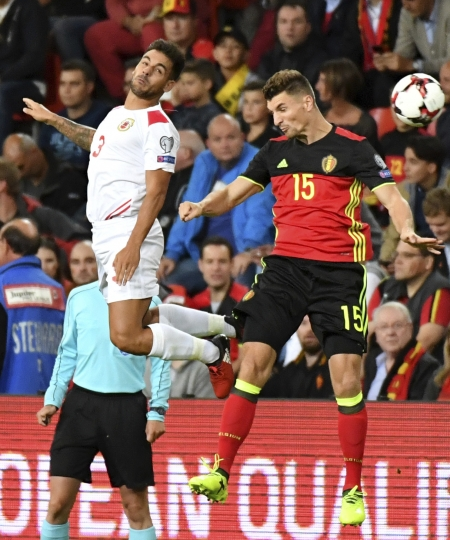 Gibraltar's Joseph Chipolina, left, goes up against Belgium's Thomas Meunier during a World Cup 2018 Group H qualifying soccer match between Belgium and Gibraltar at the Sclessin Stadium in Liege, Belgium, Thursday, Aug. 31, 2017. (AP Photo/Geert Vanden Wijngaert)