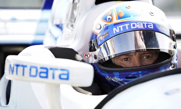 Scott Dixon sits in his car before a practice session for Sunday's IndyCar Series auto race, Friday, Sept. 1, 2017, in Watkins Glen, N.Y. (AP Photo/Matt Slocum)