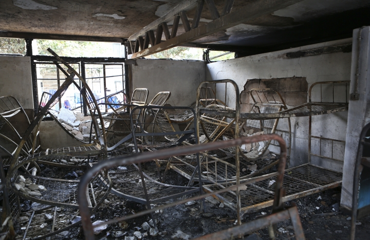 Metal bed frames are seen in a burned-out dormitory, following a fire at the Moi Girls High School in Nairobi, Kenya, Saturday, Sept. 2, 2017. Seven girls died early Saturday when a fire gutted their dormitory at the high school in Kenya's capital, the country's education minister said. (AP Photo/Brian Inganga)