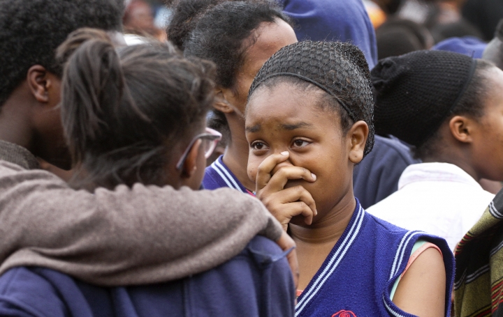 A student gestures as she stands with others, following a fire at the Moi Girls High School in Nairobi, Kenya Saturday, Sept. 2, 2017. Seven girls died early Saturday when a fire gutted their dormitory at a high school in Kenya's capital, Nairobi, the country's education minister said. The cause of the fire was unknown, Fred Matiangi said. Moi Girls High School will be closed for two weeks to allow for investigations. (AP Photo)