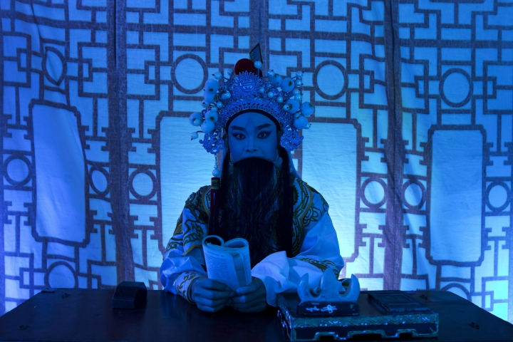 "In this Aug. 30, 2017, photo, a Chinese opera actor performs at a makeshift theater during the ""Hungry Ghost Festival"" in Hong Kong. Countless hungry and restless ghosts are roaming Hong Kong, and the world, to visit their living ancestors, at least according to Chinese convention. In traditional Chinese belief, the seventh month of the lunar year is reserved for the Hungry Ghost festival, or Yu Lan, a raucous celebration marked by feasts and music.(AP Photo/Kin Cheung)"