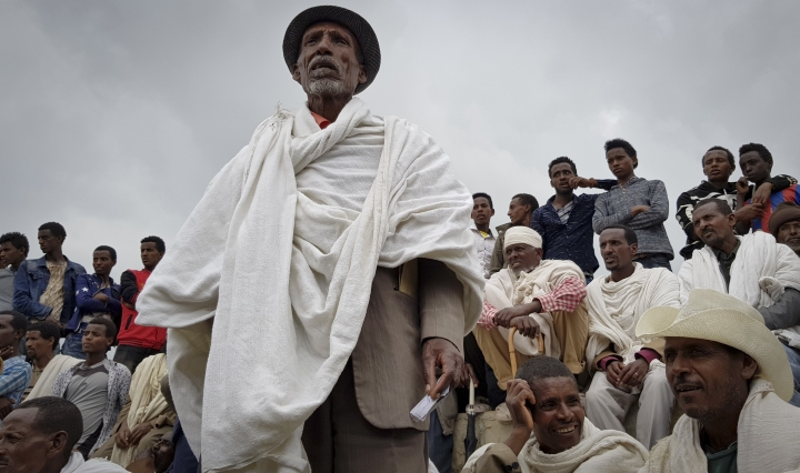 In this photo taken Saturday, Sept. 2, 2017, a farmer tells a visiting UN delegation how they were able to fight drought, at the Adi Felesti irrigation project in the northern Tigray region of Ethiopia. Despite economic growth in the past decade that has made Ethiopia one of Africa's fastest-developing countries, rural areas are suffering as the nation faces its worst drought in years. (AP Photo/Elias Meseret)