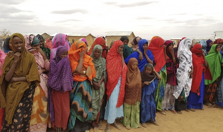 In this photo taken Sunday, Sept. 3, 2017, Ethiopian women wait in line to receive food aid due to drought conditions in the Danan district of the Somali region of Ethiopia, which hasn't seen significant amounts of rain in the past three years. Despite economic growth in the past decade that has made Ethiopia one of Africa's fastest-developing countries, rural areas are suffering as the nation faces its worst drought in years. (AP Photo/Elias Meseret)