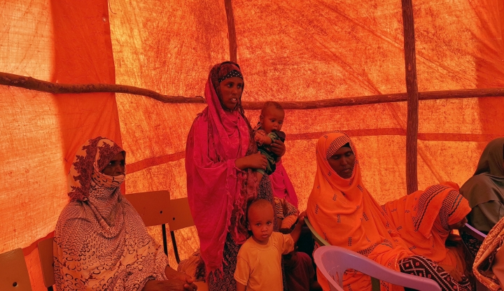 In this photo taken Sunday, Sept. 3, 2017, Ethiopian women wait in a tent to receive food aid due to drought conditions in the Danan district of the Somali region of Ethiopia, which hasn't seen significant amounts of rain in the past three years. Despite economic growth in the past decade that has made Ethiopia one of Africa's fastest-developing countries, rural areas are suffering as the nation faces its worst drought in years. (AP Photo/Elias Meseret)