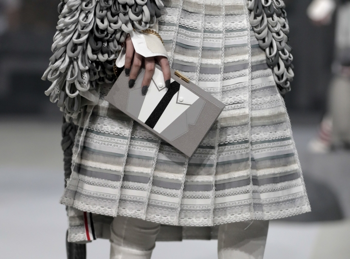 FILE - In this Wednesday, Feb. 15, 2017, file photo, the Thom Browne collection is modeled during Fashion Week, in New York. The New York fashion world gathers Wednesday, Sept. 6, to honor designer Browne with the annual Couture Council Award for Artistry of Fashion from the Fashion Institute of Technology. Browne, who regularly puts on the most fascinating, theatrically stunning shows in all of Fashion Week, won't be showing here: He's moving his women's shows to Paris, where he already shows his menswear. (AP Photo/Julie Jacobson, File)