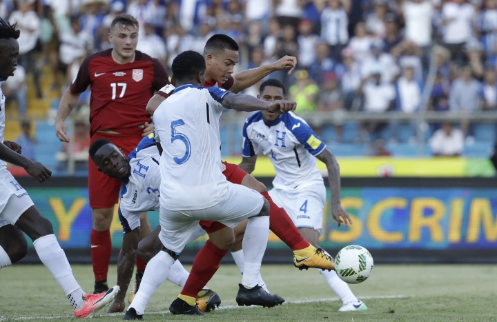 United States' Bobby Wood, 9, kicks the ball to score his team's first goal during a 2018 World Cup qualifying soccer match against Honduras in San Pedro Sula, Honduras, Tuesday, Sept. 5, 2017. (AP Photo/Rebecca Blackwell)