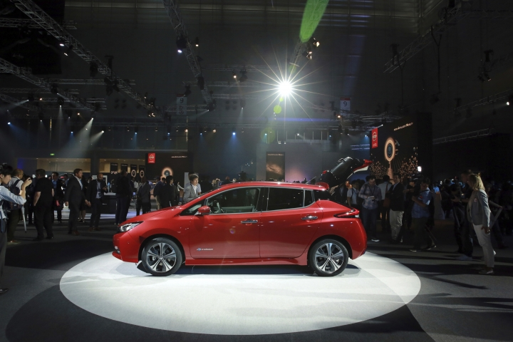 New Nissan LEAF electric vehicle is displayed after the world premiere in Chiba, near Tokyo, Wednesday, Sept. 6, 2017. Nissan's new Leaf electric car goes farther on a charge and comes with autonomous drive technology and single-pedal driving. But whether it can catch on with anyone but the most zealously green-minded remains to be seen. (AP Photo/Eugene Hoshiko)