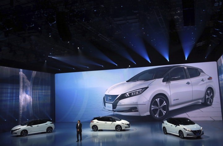 Nissan President and CEO Hiroto Saikawa unveils its new Leaf electric vehicle during the world premiere in Chiba Wednesday, Sept. 6, 2017. Nissan is turning over a new Leaf with the latest version of the world's top-selling electric car. (AP Photo/Eugene Hoshiko)