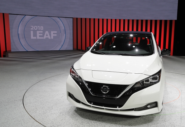 The 2018 Nissan Leaf is on display during an unveiling event, Tuesday, Sept. 5, 2017, in Las Vegas. Japanese automaker Nissan Motor Co. unveiled its zero-emissions vehicle in the U.S. late Tuesday. (AP Photo/John Locher)