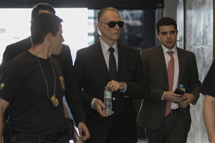 Carlos Nuzman, president of the Brazilian Olympic committee, arrives at Federal Police headquarters in Rio de Janeiro, Brazil, Tuesday, Sept. 5, 2017. Federal police searched Nuzman's house Tuesday morning. French and Brazilian authorities have been working on a corruption investigation involving bribery surrounding the awarding of the 2016 Rio Games and the 2020 Tokyo Games. (AP Photo/Leo Correa)