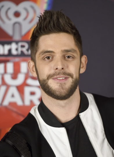 """FILE - In this March 5, 2017 file photo, Thomas Rhett poses in the press room at the iHeartRadio Music Awards in Inglewood, Calif. At 27, country singer Thomas Rhett is enjoying an abundance of blessings and just trying to make sense of it all. The title track of Rhett's new album """"Life Changes"""" is his bio put to song as he deals with fame, accolades and becoming a father of two girls. (Photo by Jordan Strauss/Invision/AP, File)"""