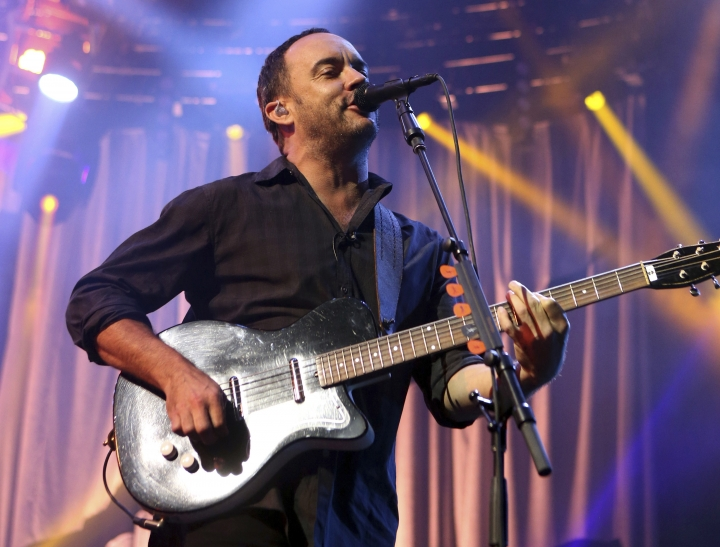 FILE - In this June 28, 2013, file photo, Dave Matthews of The Dave Matthews Band performs onstage at the Susquehanna Bank Center in Camden, N.J. The Dave Matthews Band, Justin Timberlake, Pharrell Williams and Ariana Grande will be among the performers at a free unity concert in Charlottesville on Sept. 24, 2017. (Photo by Owen Sweeney/Invision/AP, File)