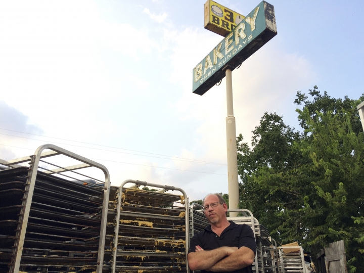 In this Sept. 2, 2017 photo, Bobby Jucker, owner of Three Brothers Bakery, cleans up storm damage at his bakery in Houston. In 2008, Hurricane Ike tore the roof off his business. Now he estimates he's facing $1 million in damage and lost revenue from Hurricane Harvey, the fifth time a storm has put his bakery out commission. (AP Photo/Brian Melley)