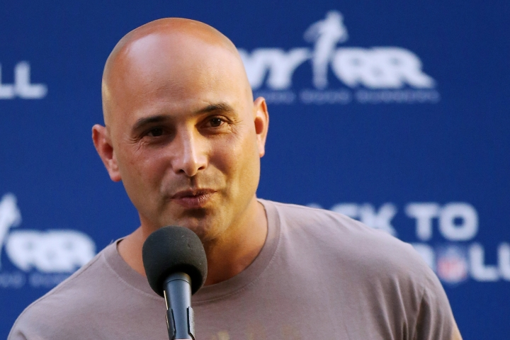 """FILE - In this Aug. 30, 2012, file photo, Craig Carton talks during the National Football League Back to Football Run at Central Park in New York. Federal officials said the New York sports radio host is in custody and details of the charges against the host of WFAN-AM's """"Boomer and Carton"""" show were not immediately made public Wednesday, Sept. 6, 2017. (John Minchillo/AP Images for NFL, File)"""