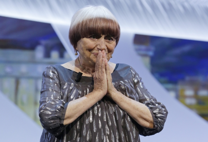 FILE- In this May 24, 2015, file photo, director Agnes Varda reacts as she walks on stage to be presented the honorary Palme d'Or award during the awards ceremony at the 68th international film festival, Cannes, southern France. Writer-director Charles Burnett, cinematographer Owen Roizman, Varda and actor Donald Sutherland are getting honorary Oscars this year. The film academy announced Wednesday, Sept. 6, 2017, that the four filmmakers will receive Oscar statuettes at the ninth annual Governors Awards ceremony in November. (AP Photo/Lionel Cironneau)