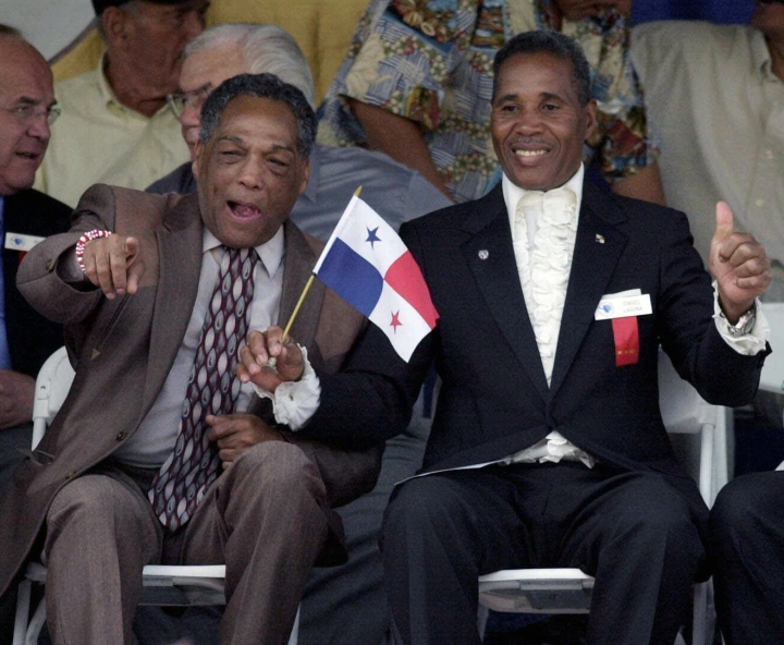 FILE - In this June 10, 2001, file photo, International Boxing Hall of Fame inductees Sugar Ramos of Mexico, front left, and Ismael Laguna of Panama, gesture during induction ceremonies in Canastota, N.Y. Ramos, the Cuban featherweight champion whose fists led to two deaths in the ring, has died in Mexico City. He was 75. The World Boxing Council said he died Sunday, Sept. 3, 2017, of cancer. (AP Photo/Kevin Rivoli, File)