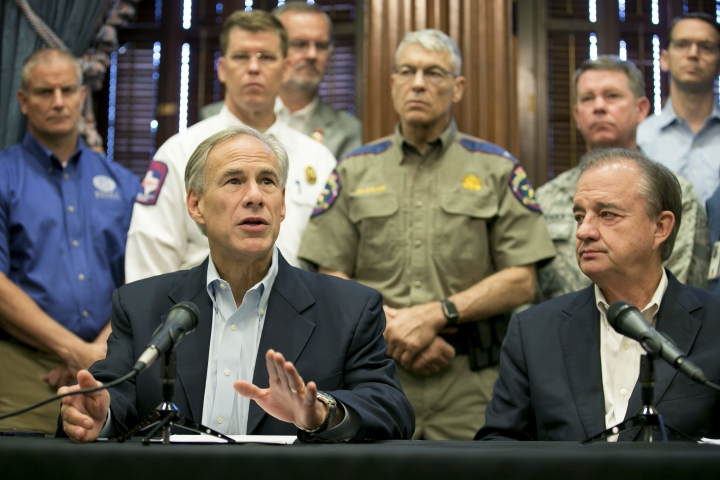 Gov. Greg Abbott, left, announces that Texas A&M University System Chancellor John Sharp, right, will head the Rebuild Texas initiative following Hurricane Harvey, at the Capitol in Austin, Texas, Thursday, Sept. 7, 2017. (Jay Janner/Austin American-Statesman via AP)