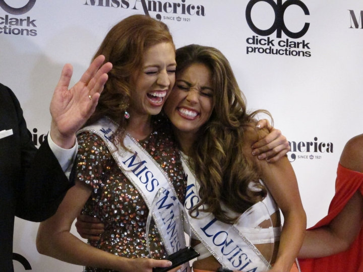 """Miss Minnesota Brianna Drevlow, left, and Miss Louisiana Laryssa Bonacquisti, right, meet reporters after winning preliminary competitions Thursday night Sept. 7, 2017 in the Miss America competition in Atlantic City, N.J. Drevlow won for playing a rendition of """"Rhapsody In Blue"""" on the piano, and Bonacquisti won the swimsuit competition. (AP Photo/Wayne Parry)"""