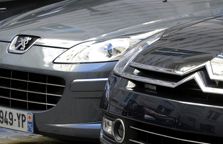 FILE - In this Sept. 7, 2012 file photo, a Peugeot, left, and Citroen cars are parked in Paris. Shares in French carmaker PSA Group have tumbled because of a report that investigators found a company-wide strategy to trick diesel emissions tests on Peugeot and Citroen cars. PSA vigorously denied wrongdoing and threatened to file a complaint over the report Friday in Le Monde newspaper, citing extensively from what it said was a report by fraud investigators. (AP Photo/Jacques Brinon, File)
